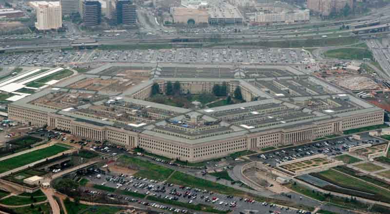 """FILE - This March 27, 2008, aerial file photo, shows the Pentagon in Washington.  The Pentagon is reconsidering its awarding of a major cloud computing contract to Microsoft after rival tech giant Amazon protested what it called a flawed bidding process. U.S. government lawyers said in a court filing this week of March 13, 2020  that the Defense Department """"wishes to reconsider its award decision"""" and take another look at how it evaluated technical aspects of the companies' proposals to run the $10 billion computing project. (AP Photo/Charles Dharapak, File)"""